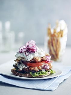Greek Open Faced Burgers with Cucumber Sauce, Tomatoes and Shaved Red Onion Served with Lemon Oregano Potatoes