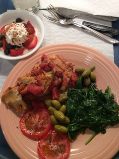 "Trader Joes free-range chicken with bruschetta & artichoke with a side of sautéed spinach & TJ's ""world's best"" olives."
