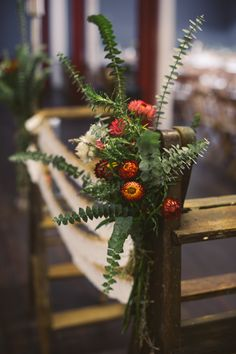 Escort cards on ladder with pretty florals captured by De-Alma-e-Coração | onefabday.com