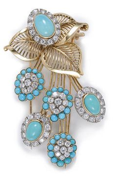 A turquoise and diamond floral motif brooch, French set with cabochon turquoise and round brilliant-cut diamonds; with French assay mark; estimated total diamond weight: 3.15 carats; mounted in eighteen karat bicolor gold; length: 2 13/16in.