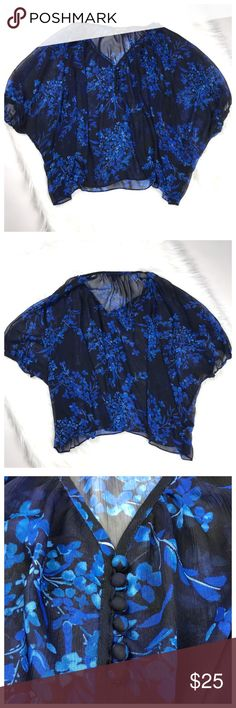 Express blue floral sheer top. Size XS Express blue floral sheer top. Size XS. Button detail on front. Excellent condition! Express Tops Blouses