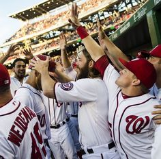 Washington Nationals celebrate a HR. Ian, the official batting helmut remover, has his removed by Jayson.