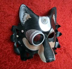 Industrial Dire Wolf Leather Mask V1... handmade mixed media leather steampunk wolf mask. $225.00, via Etsy.