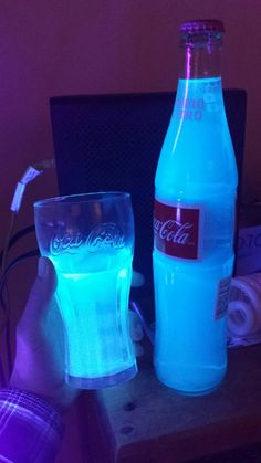 Nuka Cola Quantum: 1/3 bottle mt dew voltage, 5 shots pinnacle whipped/traditional vodka, 1 shot blue curacao liquer, tonic water