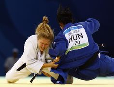 Ronda Rousey - First American to win a medal in Olympic Women's Judo. Bad@$$ to the bone...LOVE this chick!