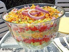Chilled Stacked Salad is a colorful and easy make-ahead layered salad that is perfect for easy summer entertaining. Stack up this fresh-tasting, time-saving salad soon. Read more at http://www.mrfood.com/Misc-Salads/Chilled-Stacked-Salad#DZMTUyZ2JsJsmKTS.99