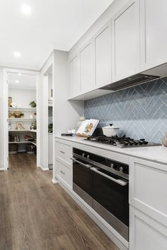 Blue herringbone tiles add a touch of elegance to the kitchen in our Waldorf 44 home on display at Albright