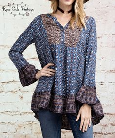 The mixed prints on this boho inspired top are AMAZING! Add in the subtle details of the ruffled sleeves and hemline, and we are in love! The fit is very free and flattering on all body types. 100% Ra
