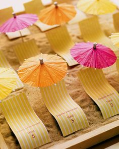 DIY Beach Wedding Inspiration Idea - Add happy summer colors to your beach-themed wedding with these place cards of chaise lounges and parasols! ... these would also be great for a reception after you've come home from a destination wedding