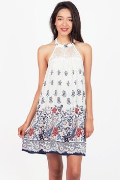 "Ultra light A-line halter dress with a lace panel on the neckline and a intricate paisley print. Open back with a stretchy band for a comfortable fit. *Hand Wash Cold*100% Rayon*33""/84cm Top to Bottom - measured on a size M (Model is 5'10/wearing size M)*Imported  #dresses #boho #paisleyprint #halterdress #sleevelessdresses #cocktaildresses #pinkice"