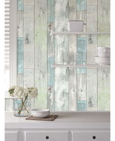 Transform a room with ease with this simple to use Beachwood peel and stick wallpaper. The contemporary design features a realistic wood panel effect in multi-tonal shades of silvery blue and white. Ideal for feature walls