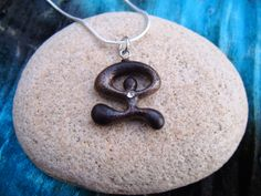 Wood INDALO Amulet Protection Good Luck Pendant Necklace With FREE CHAIN. $14.95, via Etsy.