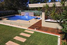 A swimming pool, swimming bath, wading pool, or paddling pool is a structure designed to hold water to enable swimming or other leisure activities. Pools can . Swimming Pool Plan, Swimming Pool Waterfall, Swimming Pool Landscaping, Swimming Pool Designs, Fence Landscaping, Pool House Designs, Backyard Pool Designs, Backyard Pergola, Backyard Pools