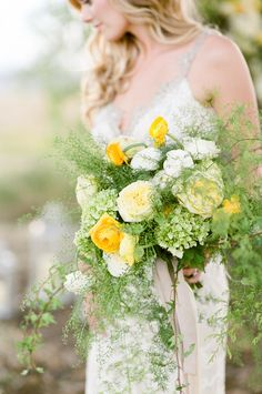 Hydrangea, ranunculus, rose, and greenery wedding bouquet: Photography : Tamara Gruner Photography | Floral Design : Isabelle Kline Designs Read More on SMP: http://www.stylemepretty.com/little-black-book-blog/2016/11/10/yellow-fall-wedding-inspiration-shoot/