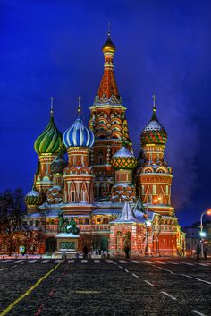 Moscow - St Basil's Cathedral at Night. Bc it's so colorful, it looks like a make believe land