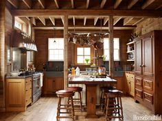 """Don't: Be boring. """"The best kitchens have a soul or a spirit that's warm, inviting, and personal,"""" designer Mick De Giulio says. """"Every project is a chance to do something new and creative. It's not just about the cabinets and countertops — the whole room has to sing."""" Adhering to that principle, he updated an Illinois kitchen in an old barn by keeping the architecture of the horse stalls, adding a tongue-in-cheek stovepipe to the range, and installing a pot rack that resemble a wagon…"""