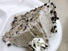 "Oreo cookie cake using white cake mix and oreos for cake. Then using more oreos cream cheese powdered sugar for frosting. Recipe for layered 8"" rounds but can use 13x9"