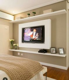Nice Shelves Idea With The TV Set In Between.