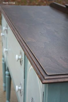 Strip and re-stain a buffet top, with painted Duck Egg body, with vintage knobs!