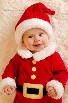 He makes the cutest little Santa's helper
