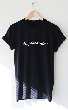 "- Description - Size Guide Details: Unisex fit graphic t-shirt in black with print featuring 'Daydreamin'. Brand: NYCT Clothing. 100% Cotton. Made in USA. Sizing: 34"" / 86.36 cm width 27""/ 68.58 cm le"
