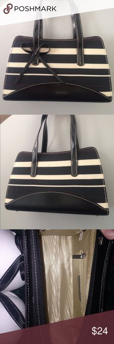 Mini, Black & Beige, Striped purse w/ Bow in front This mini handbag is small but perfect for carrying the essentials! Two pockets inside as well as a zipper closure to keep your belongings safe! No major wear and tear except for a small, barely noticeable pen mark on the front, shown in the images. Bags