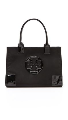 Carry everything and look great doing it with this Tory Burch Nylon Mini Ella Tote!