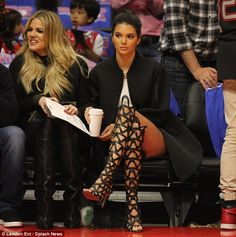 Enjoying the view: Kendall sipped on a warm beverage as she enjoyed the game with her famo...