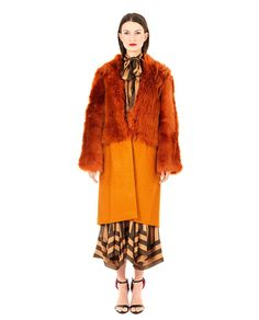 PETAR PETROV Orange overcoat with lining deep V-neck long sleeves two front pockets hidden button closure 100% Lamb Skin Insert: 100% WV Lining: 100% CU