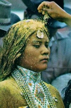 This is a common mistake. This picture was listed as a Navajo woman where in actuality she is an Apache youth who is being indoctrinated into the tribe as a woman. She is being covered in pollen to bring fertility not only to her but to the entire tribe. Winter Bear