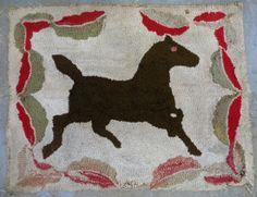 Folk art hooked rug of prancing horse