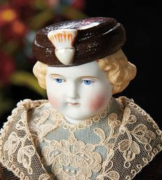 German Bisque Doll with Rare Brown Sculpted Pillbox Hat --Germany, circa 1880, attributed to Alt, Beck and Gottschalk; two variations of the model are shown in German Parian Dolls by Mary Krombholz, page 38.