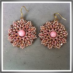 Earrings with Swarovsky crystals, Superduo beads and a jade pearl at the center.