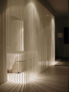 fringe curtains that are lit up are a perfect divider for modern and minimalist homes