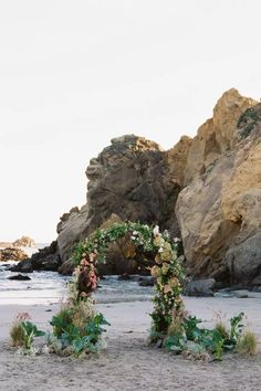 A beautiful organic arch with blush and purple florals. Photo: @erichmcvey California Coast, Big Sur, Traditional Wedding, Vows, Getting Married, Our Wedding, Wedding Flowers, In This Moment, Beach