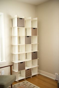 This floor to ceiling shelving unit is perfect for small apartment storage and decorating. With 21 cubes, this sleek shelving unit is an organizing force to be reckoned with! Delightful, minimalistic, and versatile.