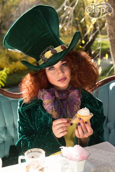 You're entirely bonkers. But I'll tell you a secret, all the best people are.  Features: The Mad Hatter hat, Jimi Hendrix Lightweight Scarf  http://www.elope.com/  2016 catalog photos by Free Spirit Colorado