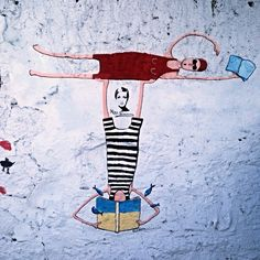Swim in books, street art in Miguel Bombarda street, Porto, Portugal.