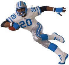 """$19.95 - Hallmark NFL Detroit Lions Barry Sanders 2017 Hallmark Keepsake Christmas Ornament - Perfect for the sports fan in your life, this NFL Detroit Lions Barry Sanders Hallmark Keepsake ornament is a special way to honor the legendary player. Hall of Fame football player Barry Sanders strikes a Heisman winner pose Pre-packaged for easy gift giving and storage Dated 2017 3.9""""H x 2.1""""W x 0.1""""D Plastic Hanging hook not included Wipe clean Model no. 1995QXI3475 Size: One Size. Color: Black."""