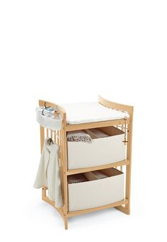 Stokke® Care is a changing table that makes nappy changes enjoyable and intimate. The changing table raises your baby higher, encouraging eye-contact. Space underneath provides room for your feet, allowing you to stand closer for better reach. Best of all, Stokke® Care has been designed so that your baby can lie facing you rather than sideways. This allows you to face your baby for play and interaction while making nappy changes far easier.
