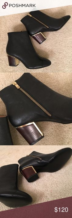 CALVIN KLEIN ANKLE BOOTS BRAND NEW!!! BRAND NEW CALVIN KLEIN ANKLE BOOTS. Black soft leather with gold detail. Size 7.5 Calvin Klein Shoes Ankle Boots & Booties