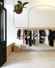 Kloke shop interior features copper clothes rails and wooden display units by sibling copper clothes rail Design Shop, Shop Interior Design, Retail Design, Interior Ideas, Rack Design, Interior Doors, Design Design, Copper Clothes Rail, Store Interiors