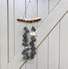 A waterfall of grey brown clay fans, attached to a branch with flax cord. Handmade Ornaments, Glazed Ceramic, Art Of Living, Twinkle Twinkle, Brown And Grey, Wind Chimes, Anniversary Gifts, House Warming, Cord