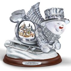 The Thomas Kinkade Illuminated Musical Sledding Snowman - Hammacher Schlemmer