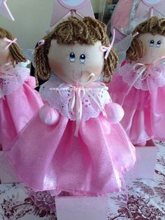 """Adorable Angel Centerpiece Mounted on a wooden box, these angels are 100% handmade. Angels pictured here meausre 12"""" tall while the accompanying star is 22"""" in height. The price includes customizing for your event. Tel. 1 562 286-3916"""