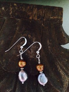 A personal favorite from my Etsy shop https://www.etsy.com/listing/248263716/vintage-inspired-pearl-earrings-gold-and