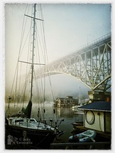 cool Seattle shot... the houseboat looks like it's floating in the mist and the sailboat seems old fashioned opposed to the steel highway bridge