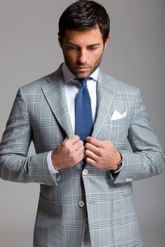 A perfect summer look! Checkered gray suit, white shirt, indigo blue knit tie, and white pocket square.