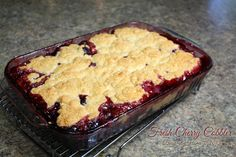 Your cobbler will be a beautiful golden brown on top, with a slightly crisp outer crust and flaky, tender insides. The thickened juice from your cherries will be bubbling around the edges of the dough.