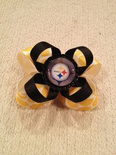 Pittsburg Steelers Hair Bow for a Baby or Little Girl - NFL inspired. $5.95, via Etsy.